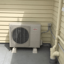 AC outdoor unit in the backyard