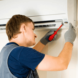 ASAP AIR employee installing air conditioner